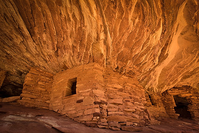 """House on Fire"" - ancient Anasazi ruins, built into a brilliant orange sandstone formation. Mule Canyon, Utah."