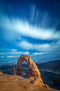 Long-exposure of Delicate Arch, showing cloud movement over several minutes. Arches National Park.