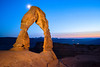 *Delicate Arch at Night*<br /> <br /> Taken about 45 minutes after the sun had gone down and all the people were going home. Long exposure with about 30 seconds of light painting, with the moon doing a star-burst behind it.<br /> <br /> © 2012 Jeff McGrath
