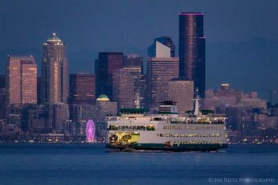 Ferry & Ferris Wheel - Seattle skyline at dusk.