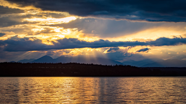 Sunset over the Olympic Mountains, from Dock Street on Bainbridge Island.