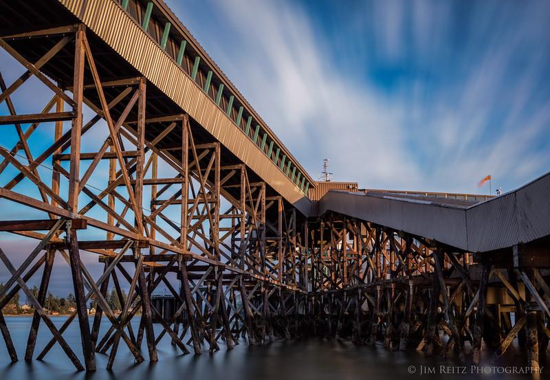 Long-exposure shot beneath the passenger ramps at the Bainbridge Island ferry terminal.