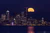Harvest moon, rising over Seattle skyline.