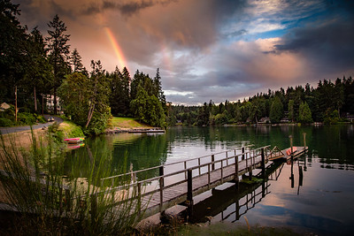Sunset rainbow over Manzanita Bay on Bainbridge Island.