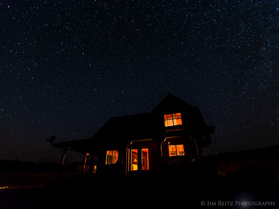 Cabin and night sky near Winthrop, Washington. Note the Big Dipper just above the left side of the cabin.