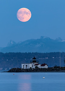 Hunter moon rising tonight, over Point No Point lighthouse near Hansville, WA.