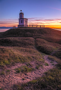 Another lighthouse, another sunset. Pathway thru the dunes, leading to Cattle Point Light on San Juan Island.