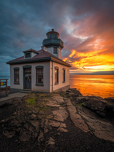 The sunset that keeps on giving! A vertical shot of a spectacular sunset at Lime Kiln lighthouse.