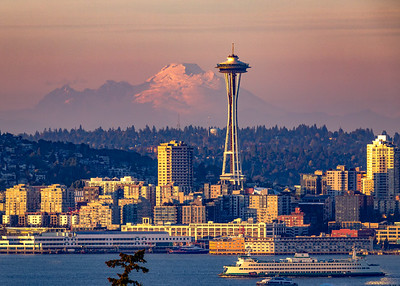 Our OTHER big white volcano - Mt. Baker - at sunset, looming behind the Space Needle.