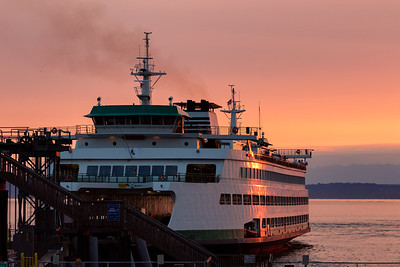 Colorful sunset along Seattle waterfront - due to smoke from Olympic Peninsula wildfire.