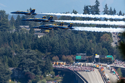 Blue Angels zoom across Seattle's I-90 bridge.