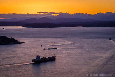 Sunset view of Puget Sound, Bainbridge Island, and the Olympic Mountains.