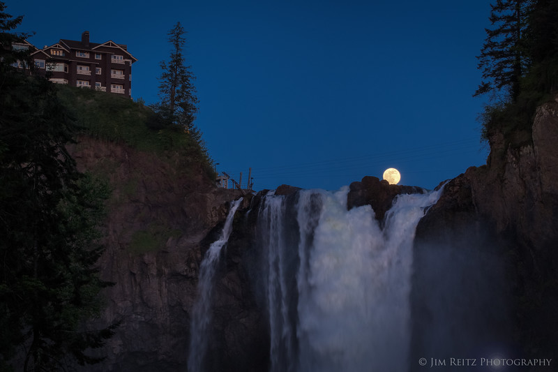 Moonrise over Snoqualmie Falls and the Salish Lodge hotel.