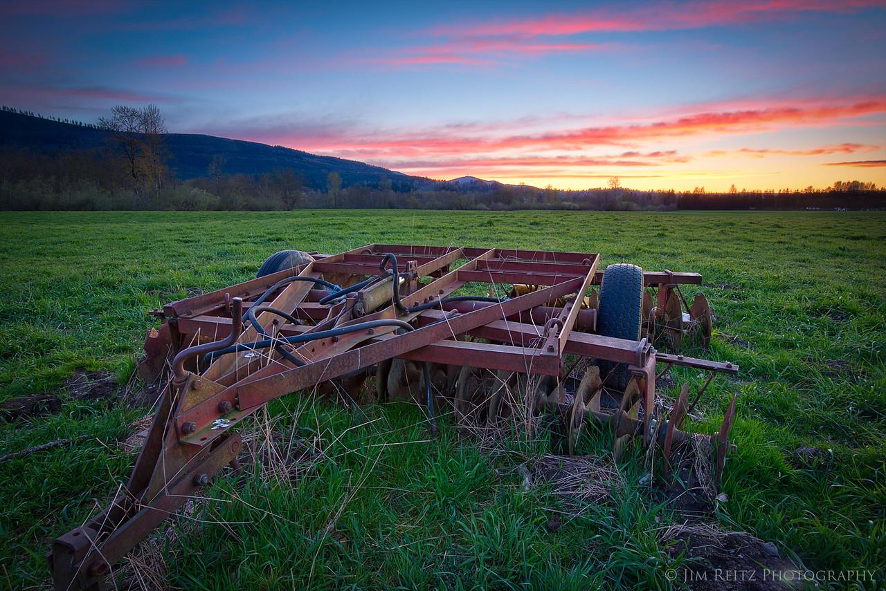 Farm equipment at sunset near Snoqualmie, Washington.