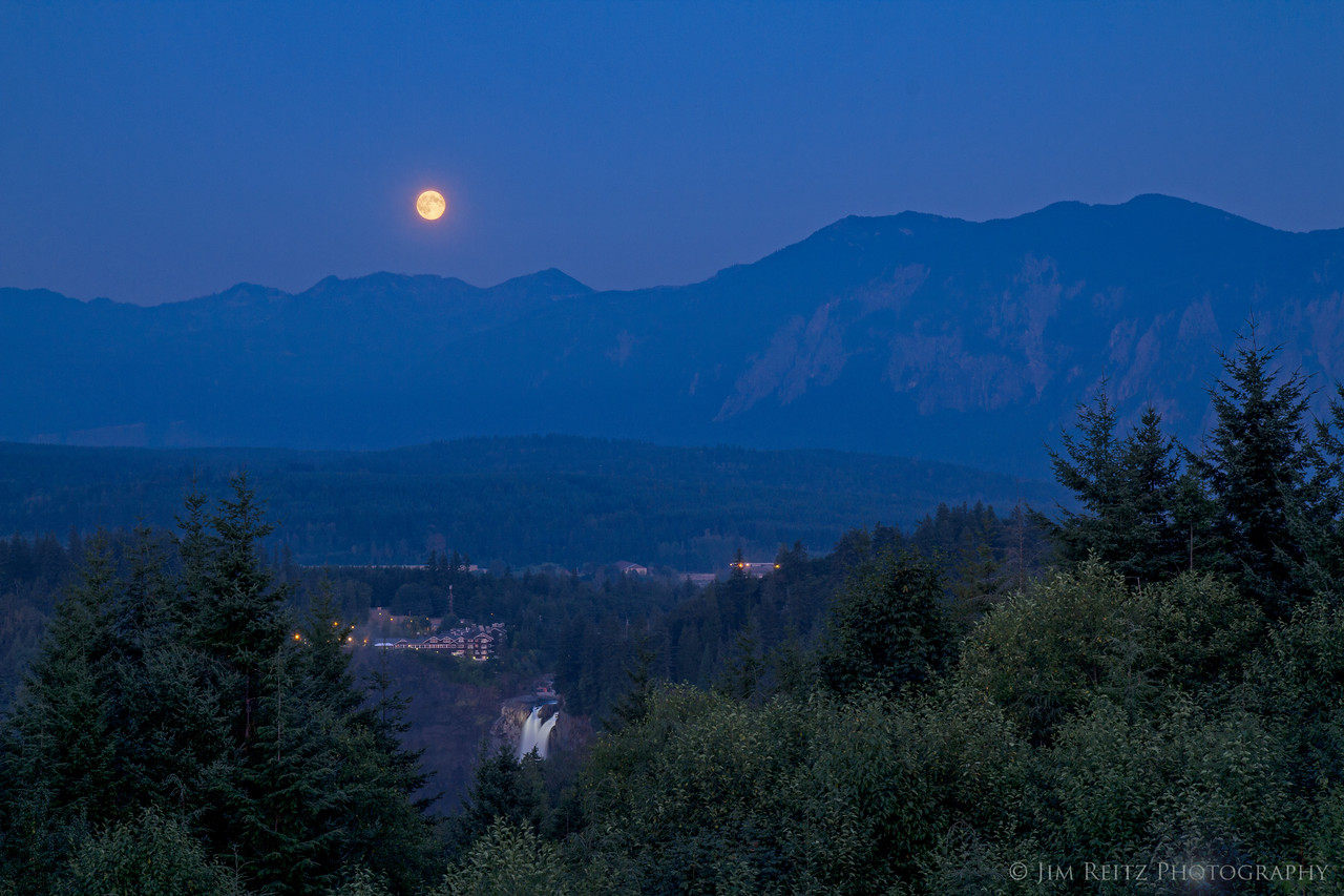 The Harvest Moon rises over Snoqualmie Falls.