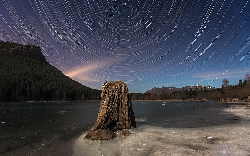 Star trails at Rattlesnake Lake near North Bend, Washington - under bright moonlight