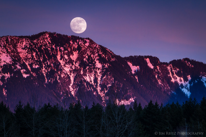 Moonrise at Rattlesnake Lake as nearby Mailbox Peak lights up with alpenglow - near North Bend, WA.