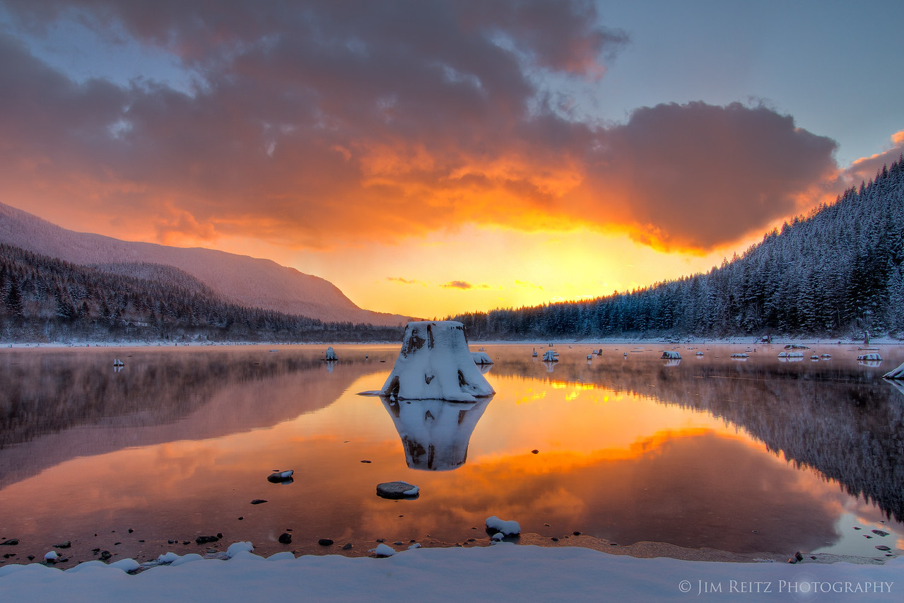 Fresh snow frames a sunset over Rattlesnake Lake near North Bend, WA