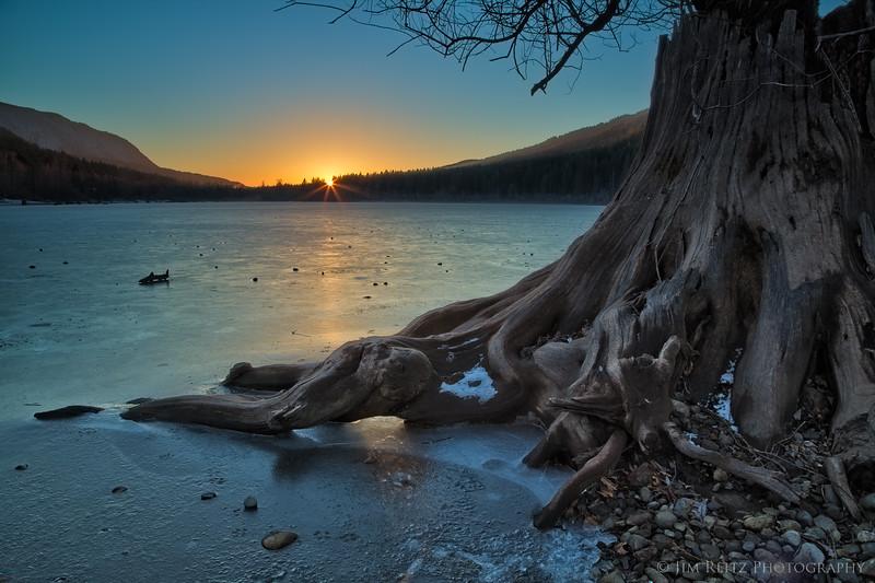 Sunset on icy Rattlesnake Lake near North Bend, Washington