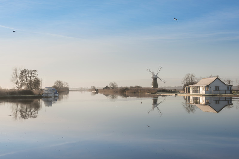 Norfolk Broads<br /> The Broads are a network of mostly navigable rivers and lakes in the English counties of Norfolk and Suffolk. The lakes, known locally as broads, were formed by the flooding of peat workings.