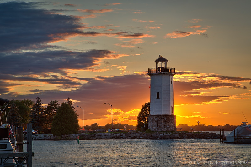 The sun sets behind the lighthouse in Fond du Lac, Wisconsin.