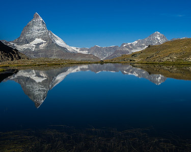 The Matterhorn and Dent Blanche reflected in the Riffelsee. Zermatt, Switzterland