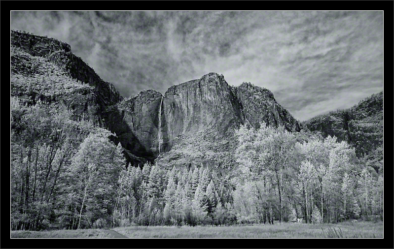 High Clouds Over Yosemite Falls  Yosemite Falls is the seventh tallest waterfall in the world, plunging 2,425 feet from the Valley wall to the Valley floor.  The Upper Yosemite Falls, seen here, drops 1430 feet. The water is fed from snowmelt in Yosemite's High Country (Sierra Nevada).  Yosemite Valley Yosemite National Park, California  13-NOV-2010