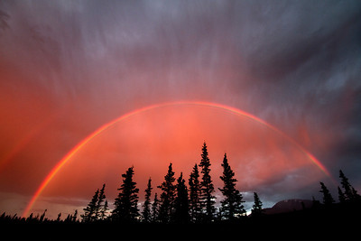 A rainbow forms in the eastern skies above the Yukon's Kluane region. July 2013.