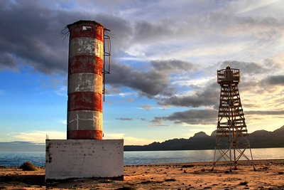The old and new lighthouses stand on the shore of Isla San Jose, in the Sea of Cortez off Baja California. November, 2013