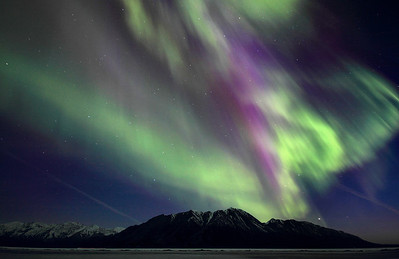 Northern Lights illuminate the skies over Sheep Mountain, in Kluane National Park.