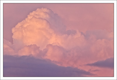 Pink Cumulus Clouds at Sunset