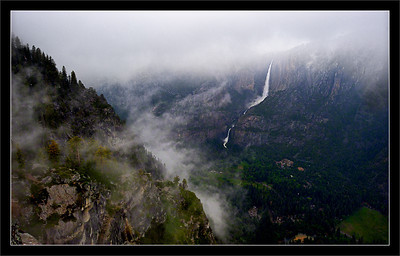 Storms in Yosemite Valley  Late-spring storm clouds bring snow and hail to Valley rim (at higher elevations) and rain to the lower elevations of a green Yosemite Valley.  (Upper and Lower Yosemite Falls are in the distance. The Valley is about 3200 ft. below this viewpoint.)  Yosemite National Park, California  28-MAY-2011
