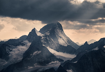 Dent Blanche (4357m) and Obergabelhorn in stormy evening light - from the Michabeljoch Bivouac