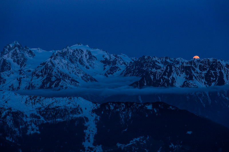 Super moon setting over the Mont Blanc Massif. Verbier, Switzerland.