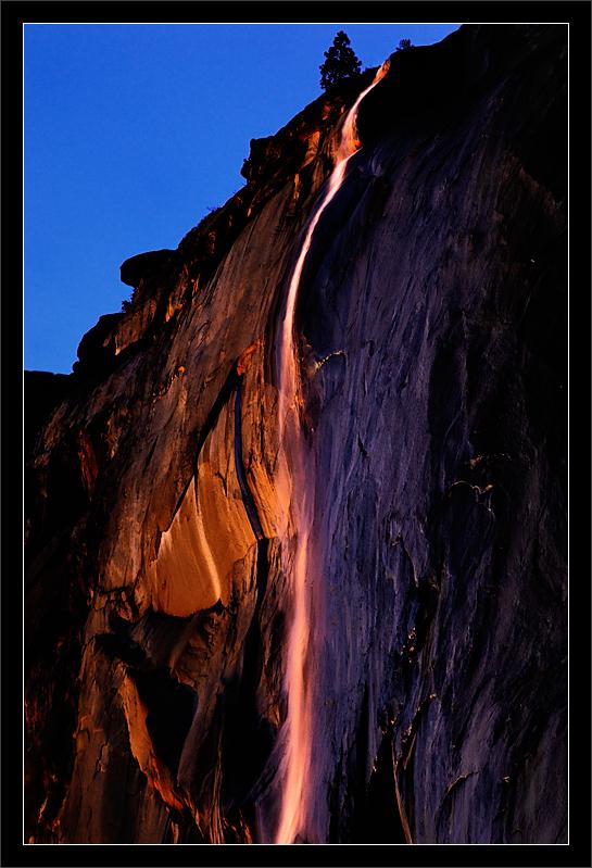 Sunset on Horsetail Fall  The setting sun illuminates Horsetail Fall on El Capitan.  Yosemite National Park, California  12-FEB-2011