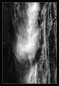 Tumbling Water on Granite Walls  Ribbon Fall, a seasonal (spring) waterfall fed by snow melts, drops water 1600 ft. down the cliffs of Yosemite Valley.  Yosemite National Park, California  26-JUN-2011