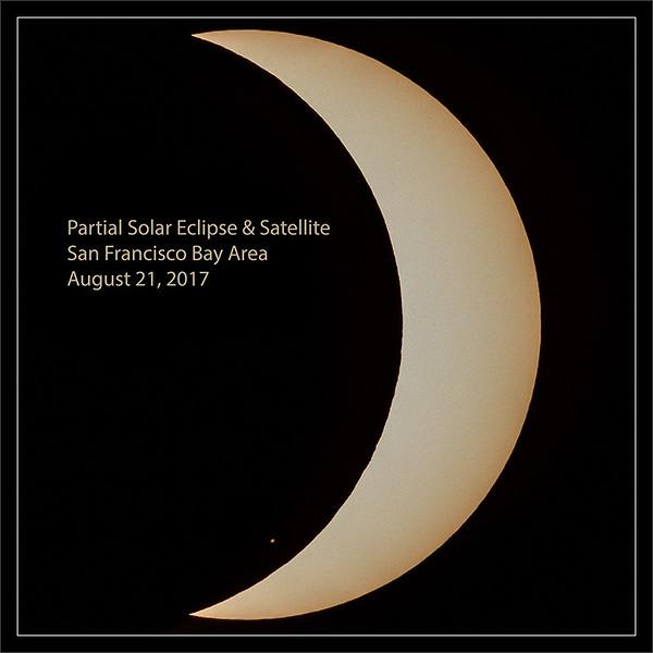 Partial Solar Eclipse & Satellite