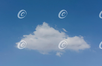 Isolated Soft and Fluffy Triangular Cloud in a Pure Blue Sky