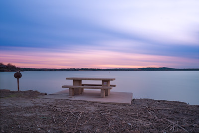 A sunset that never happened as the clouds covered more than 90% of the sky. I did not want to return empty handed after driving more than 100 miles to this location hence I captured the muted colors against the empty bench.