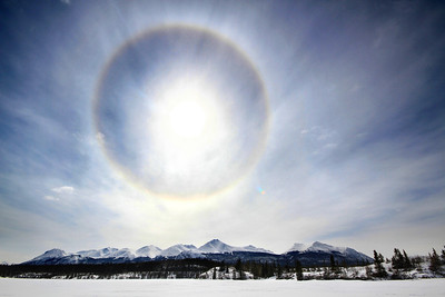 A sun halo appears in the skies over Lewes Lake and Gray Ridge, Yukon. April, 2013.