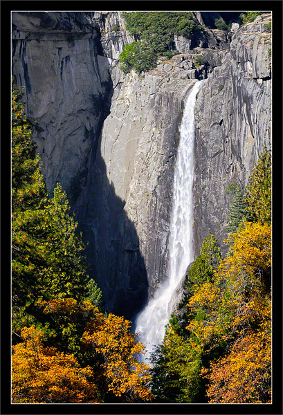 Lower Yosemite Falls & Fall Trees  Fresh snow melt supplies the water to Lower Yosemite Falls.  Normally, Yosemite Falls is dry or frozen until spring, but a fall warm front melts the higher-elevation snow packs.  Yosemite Valley Yosemite National Park, California  14-NOV-2010