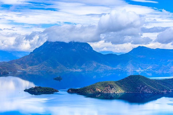 A sleeping lady lying on Lake Lugu, Lijiang, Yunnan, China