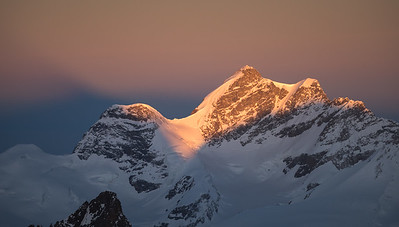 Jungfrau and her shadow at sunrise, Switzerland