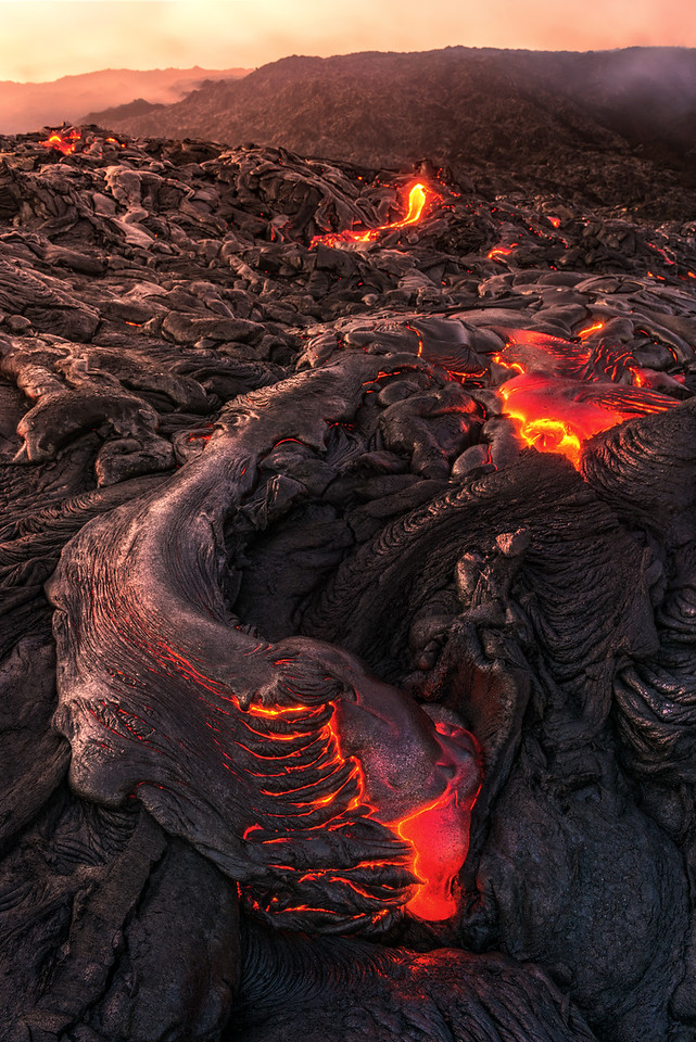 Lava from the Kilauea Volcano decends down the Pali towards the ocean in Volcanoes National Park on September 7, 2016.