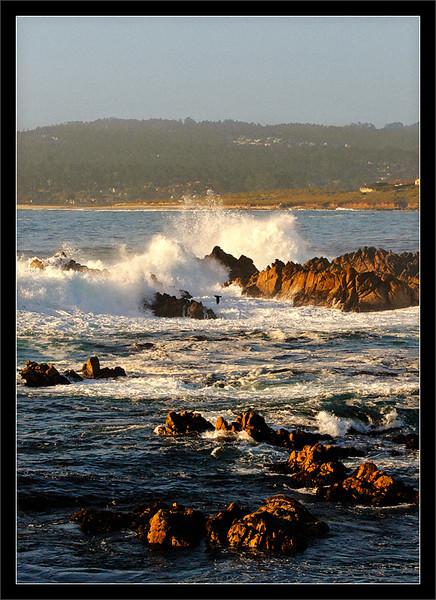 Ocean Spray in Carmel Bay  Large waves crash on rocks scattered within Carmel Bay.  Pt. Lobos State Reserve Carmel, California  03-JUL-2010