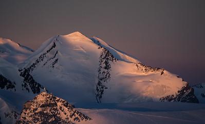 Castor and Klein Matterhorn at sunset from the Dent d'Herens