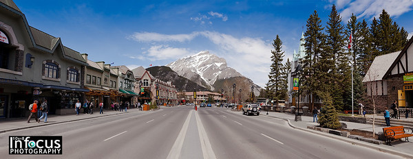 A place with a rock in the road?  Banff, Alberta, Canada.  Cascade Mountain (Stoney Chief)  2998 metres / 9836 feet.