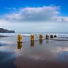 Groynes on the beach at Sandsend on the North Yorkshire Coast