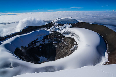 The summit crater of Cotopaxi. Chimborazo in the far distance. Ecuador.
