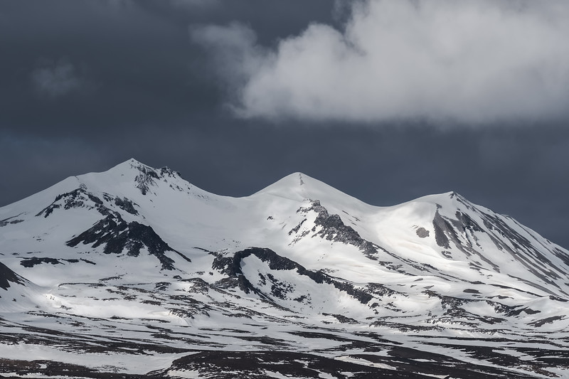 Dark skies over snow-capped mountains in Iceland